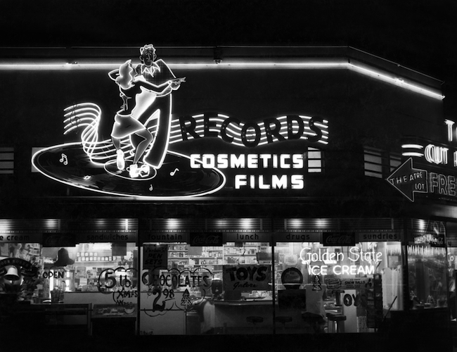 The neon sign advertising records and other items for sale at Russ Solomon's father's Sacramento drugstore.