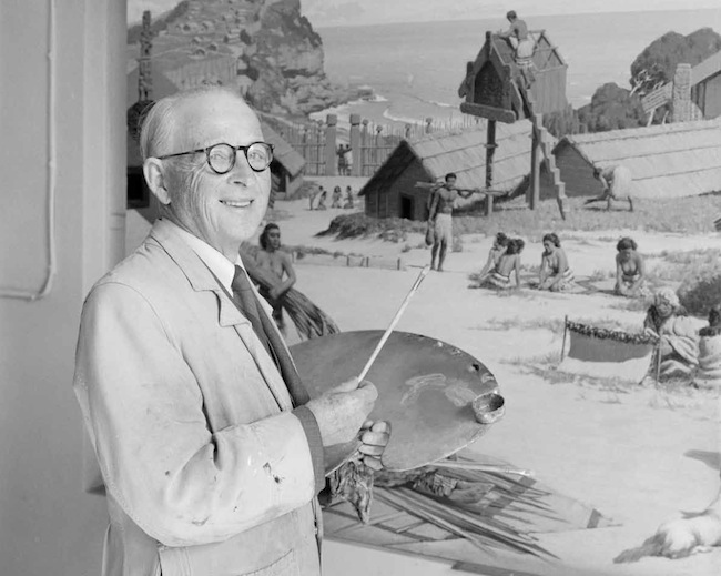 Marcus King, circa 1950, painting a Māori village scene.
