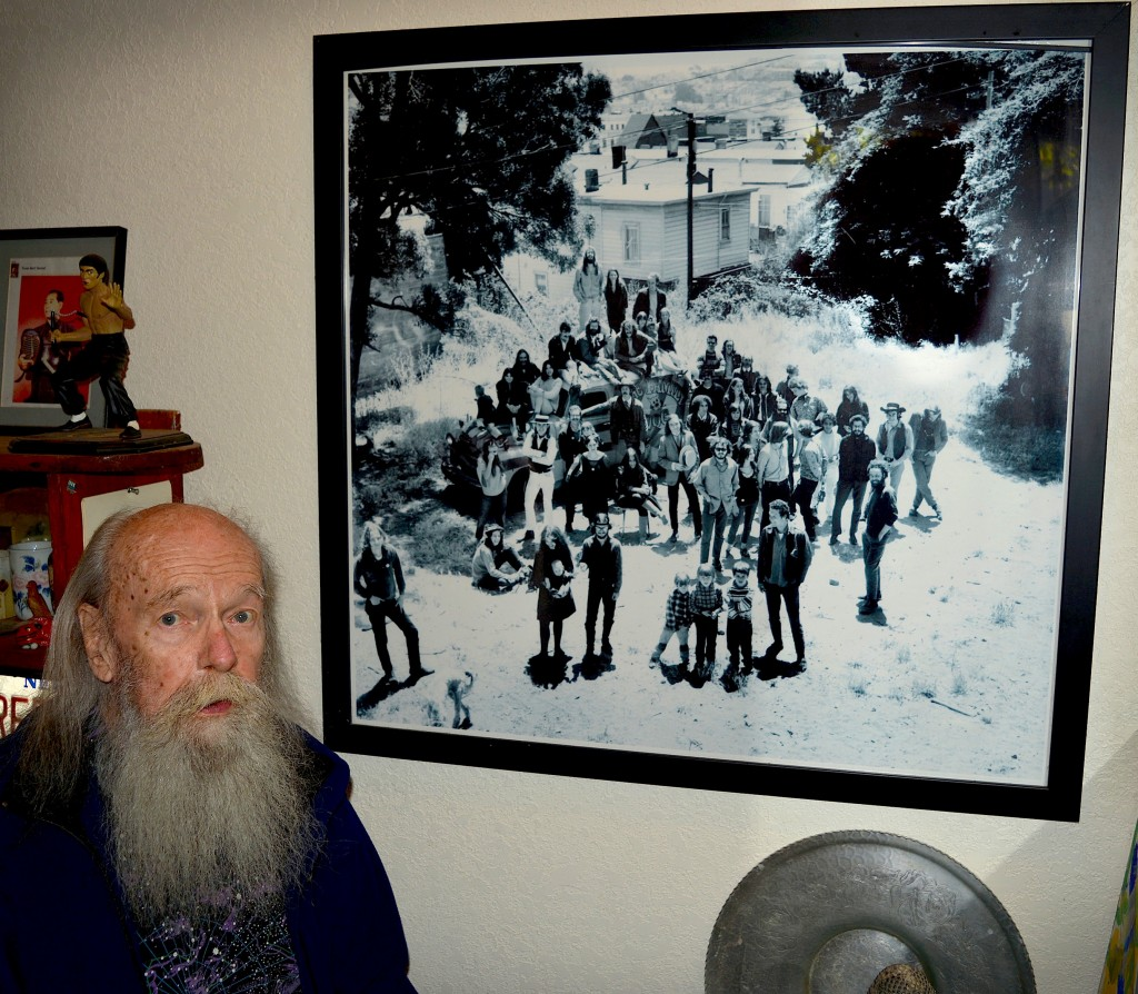 Top: A recent Bill Ham light painting from a studio session. Above: Bill Ham next to a Herb Greene photograph of the residents of Pine Street in 1966. The group—which includes members of Big Brother and the Holding Company, The Charlatans, and The Family Dog—are standing in the vacant lot between 2111 and 2115 Pine Street.