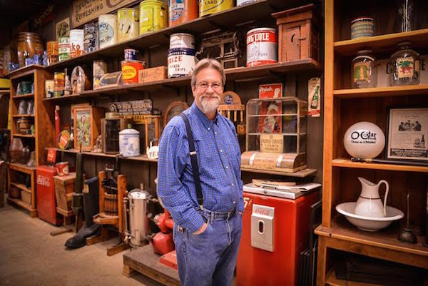 Cracker Barrel décor manager Larry Singleton stands inside the company's antiquse warehouse in Lebanon, Tennessee. (Courtesy of Cracker Barrel Old Country Store)