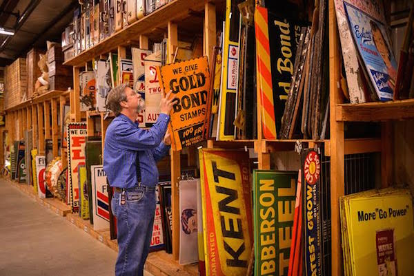 Cracker Barrel décor manager Larry Singleton peruses the sign collection in the company's 26,000-square-foot antiques warehouse. (Courtesy of Cracker Barrel Old Country Store)