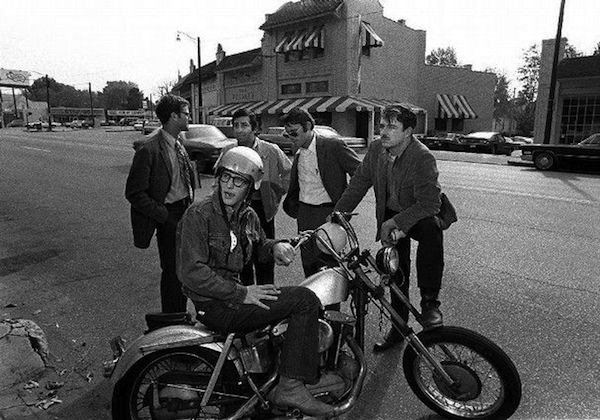 The founders of the Memphis Friday's in the 1970s: James D. Robinson Jr. sits on his motorcycle, and behind him are Ben H. Woodson, George Saig, Charles H. Hull, and Frank E. Doggrell III. (Via OvertonSquare.com)