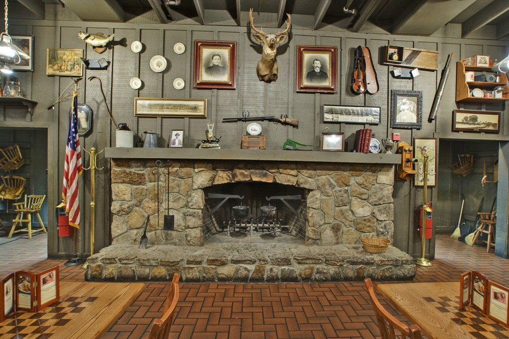 Every Cracker Barrel has a mantel with a deer head and a shotgun hanging above it. Click on the image to see a larger version. (Via Cracker Barrel Old Country Store)