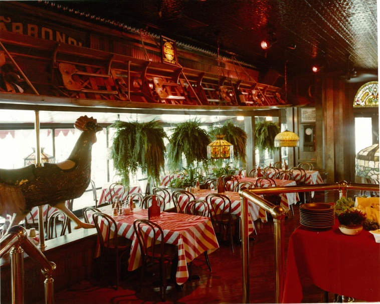 This professional promotional photo shows a T.G.I. Friday's in San Bruno, California, before it opened in 1980. Décor includes a long racing scull and a carousel rooster. (Courtesy of Bob Treat)