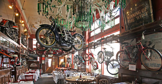 Henry Africa's collection of vintage motorcycles hung from the ceiling of Eddie Rickenbacker's in San Francisco until 2011. (Via Cyril Huze Post)