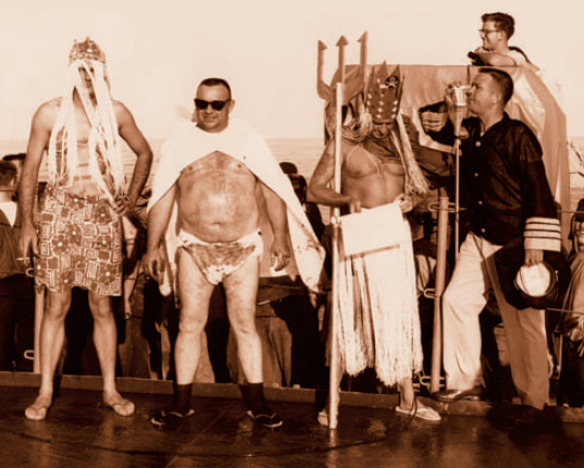 A crossing-the-line ceremony from 1965. From left to right, the Royal Queen, Royal Baby (with soiled diapers), King Neptune, and Royal Navigator. (Courtesy  Simon Bronner)