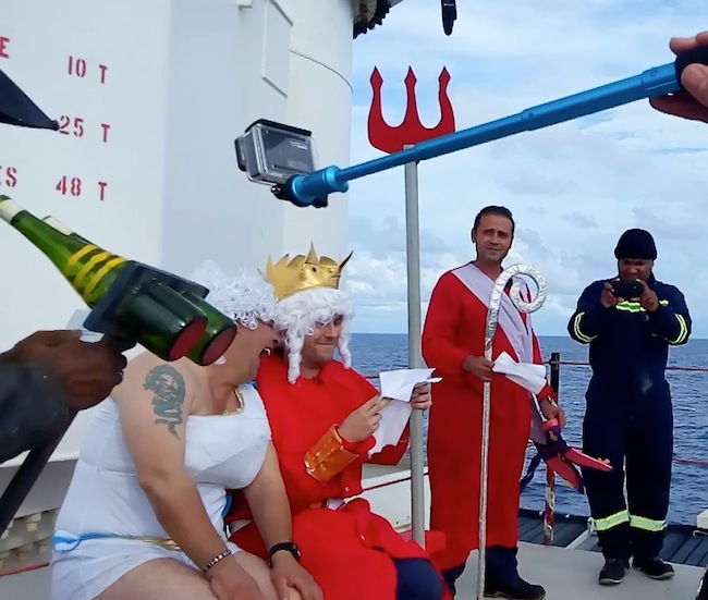 Now dressed in drag as Queen Neptune, Pascal has a laugh with his King, who, like all the other participants in the crossing-the-line ceremony I experienced, read his lines from a script.