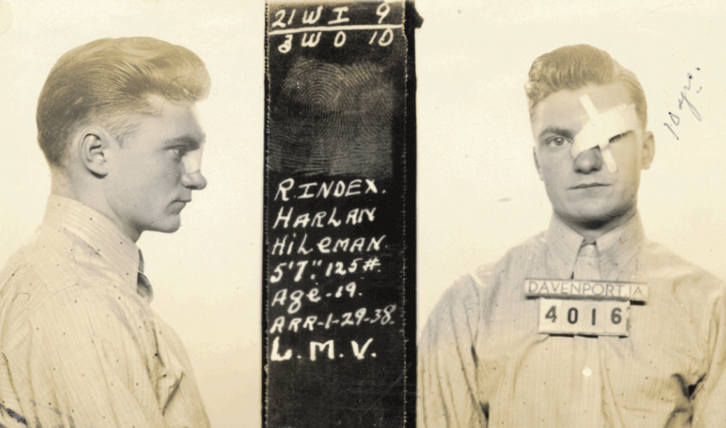 This mugshot from Davenport, Iowa, taken in 1938 captures a young man with a recent facial injury. Courtesy of Mark Michaelson.