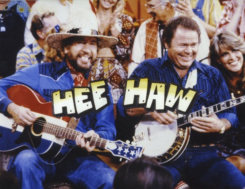 "Buck Owens (left) and Roy Clark on the ""Hee Haw"" television show, circa 1975."