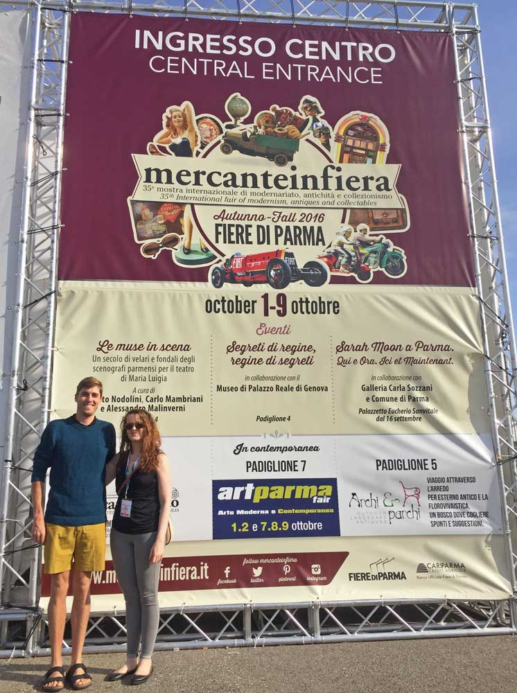 Collectors Weekly reporters Hunter Oatman-Stanford and Lisa Hix near Mercanteinfiera's main entry.
