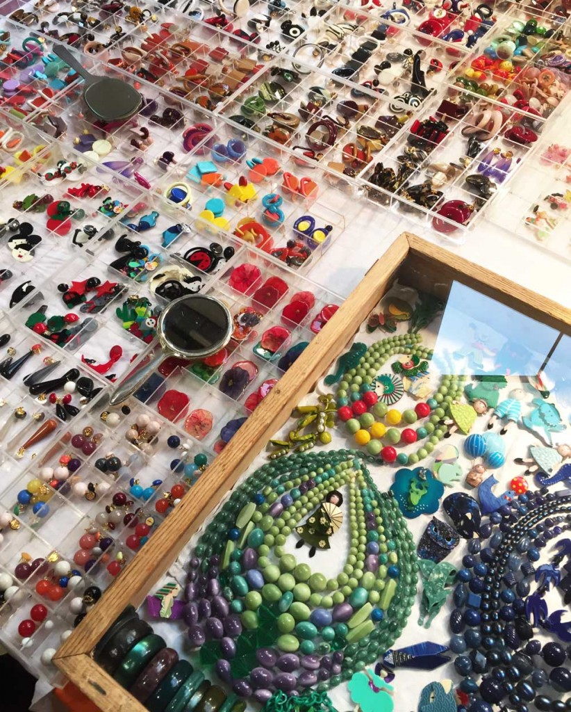 A tabletop display of colorful costume jewelry.