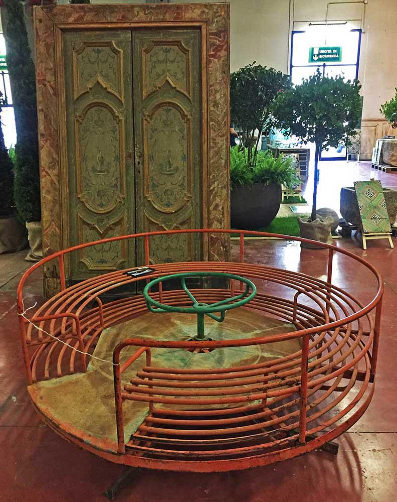 "The ""Archi e Parchi"" area includes oversized outdoor objects like this children's merry-go-round."