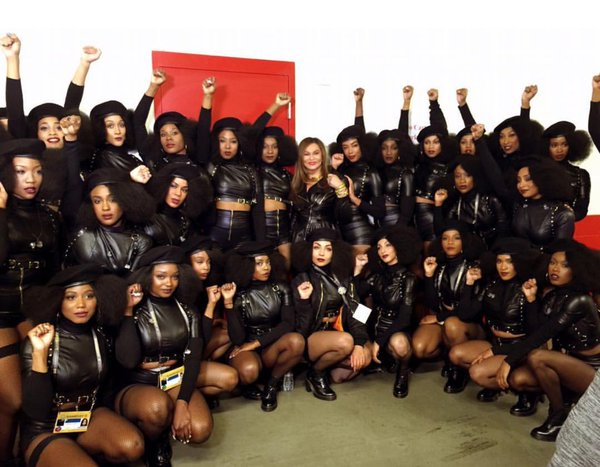 Top: From left, black activists T.C. Williams, Judy Hart, Ron Bridgeforth, and Jo Ann Mitchell at San Francisco State University in 1967. (Courtesy of Judy Juanita) Above: Beyoncé's dancers raise their fists in solidarity with the Black Panther Party backstage at Super Bowl 50 in February 2016. (Via Twitter)