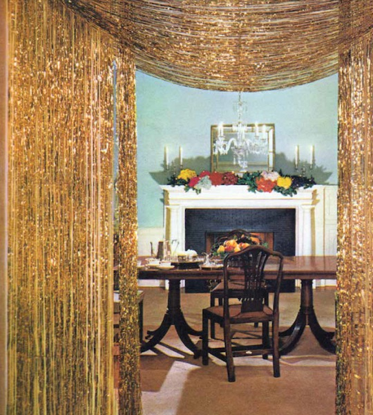 "Top: A happy housewife can't believe the abundance of Christmas presents she sees in an 1960s ad for Reynolds Metals foil gift wraps. (From Mid-Century Christmas, reproduced with permission from Reynolds Consumer Products) Above: Gold tinsel curtains adorn the entry to a dining room in the December 1961 ""House Beautiful."" (From Mid-Century Christmas, reprinted with permission of Hearst Communications, Inc.)"