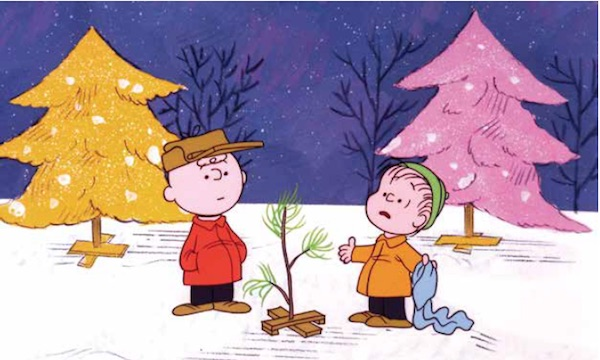 "mcchrist_charliebrownIn 1965's ""A Charlie Brown Christmas,"" Charlie and Linus look at their weather-beaten natural tree in front of yellow and pink Christmas trees that likely represented the fake, aluminum trees of the day. CBS Television animated special, directed by Bill Melendez. Photofest, Inc. (From Mid-Century Christmas)"