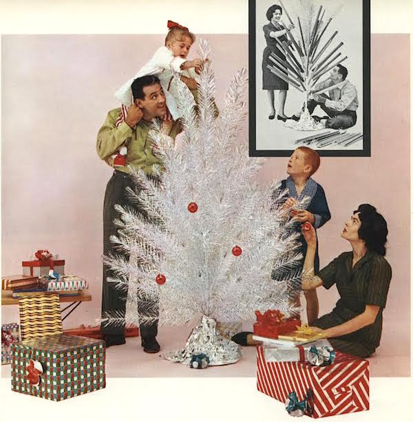 This image from a 1960 Alcoa Aluminum newsletter shows a family pulling the tubes off the branches of an aluminum tree and then decorating it with ornaments. Via Alcoa Records, Detre Library & Archives, Senator John Heinz History Center. (From Mid-Century Christmas)