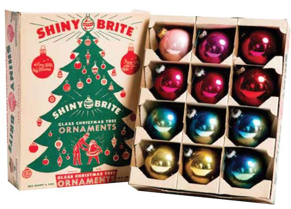 A dozen Shiny Brite ornaments, including some ombré ones, from the 1950s and 1960s, shown in a vintage box from the same period. Photo by Jeffrey Stockbridge. (From Mid-Century Christmas)