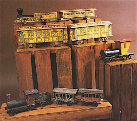 In the second half of the 19th century, wooden model trains such as the ones in the top two rows featured lithographed designs. Tin trains, at right and at bottom, were produced concurrently with wooden ones.