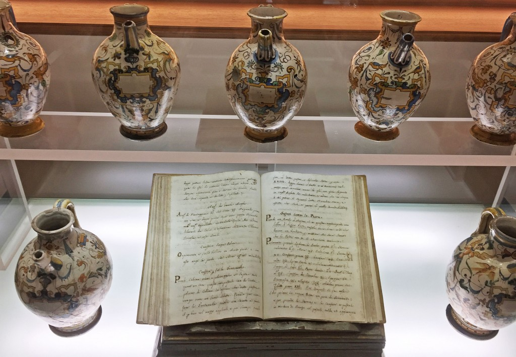 "Original texts and ceramic vessels used by the friars are housed in the shop's museum. The heading on the righthand page reads ""S<em>egreti Contro la Peste</em>"" or ""Secrets Against the Plague."""
