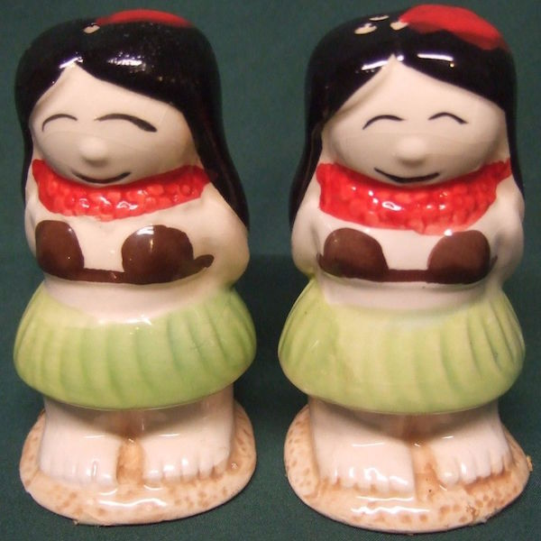 These vintage Hawaiiana souvenir salt-and-pepper shakers depict hula girls in grass skirts and coconut bras—garments that are not native to Hawai'i.