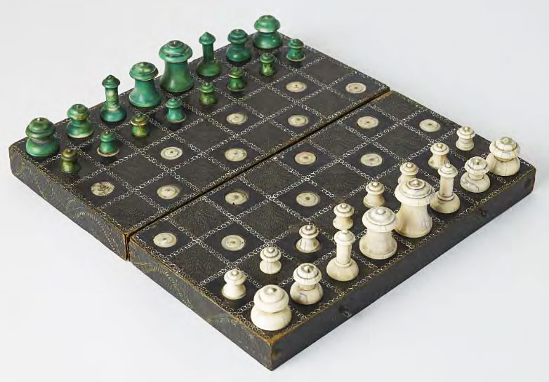 A green-and-white Muslim chess set from South Asia with ivory pieces and a lacquered-wood board, circa 1700.