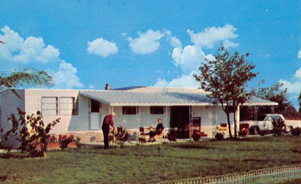 "Top: ""Life in a Trailer Park in Florida"" involved flower beds and socializing, according to this 1950s Tichnor linen postcard. Above: A 1960s advertising postcard promotes a two-bedroom trailer in the ""Mobile Home Section"" of Orange Blossom Hills, Florida. (Images via eBay)"