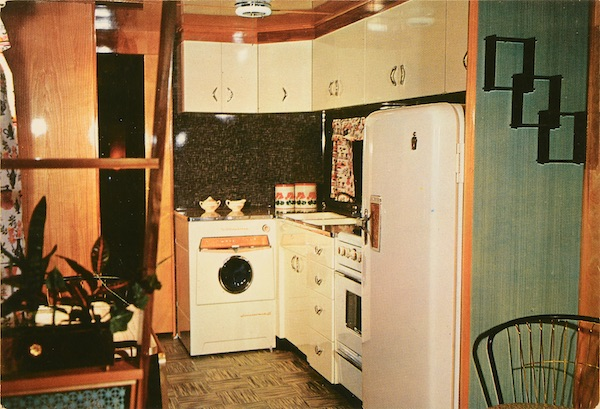 This advertising postcard for Geer Mobile Homes in Grand Island, Nebraska, circa 1950s-'60s, shows a Mid-Century Modern style kitchen with the latest appliances. (From Don't Call Them Trailer Trash, courtesy of Schiffer Publishing)