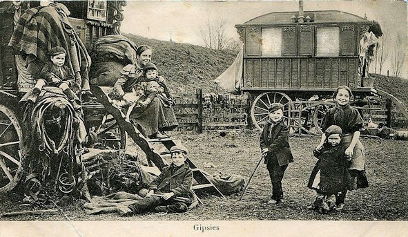 "An undated postcard shows ""gipsies"", or Romani nomads, outside their horse carriages. (Via eBay)"