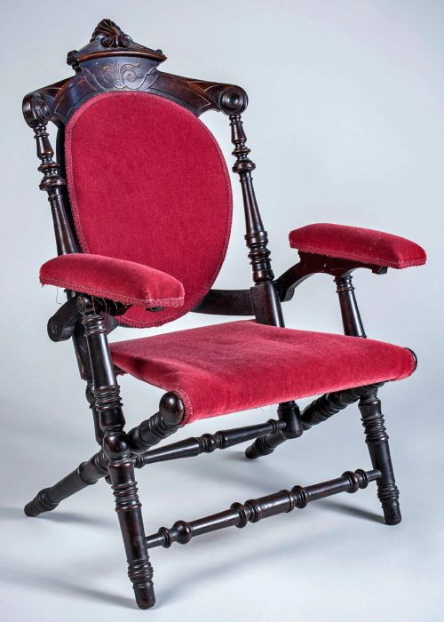 A Hunzinger X-frame armchair, circa 1870s. Via Live Auctioneers.
