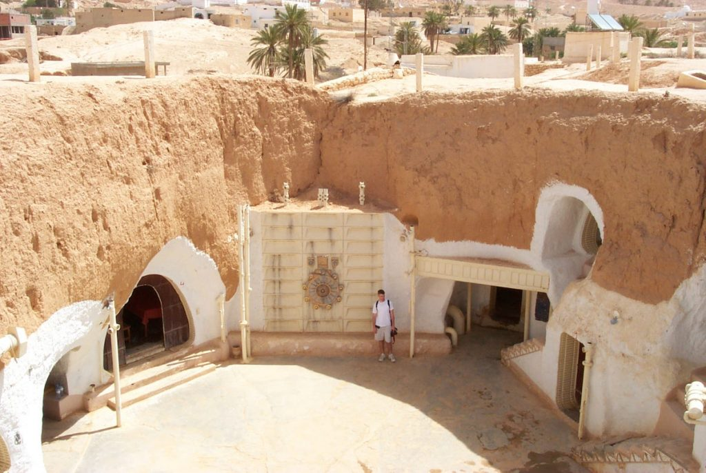 "In 2001, Alinger and his family stayed at Hotel Sidi Driss in Matmâta, Tunisia, which are centuries-old Berber cave dwellings that George Lucas selected to represent the crater homestead of Luke Skywalker's aunt and uncle in 1977's ""Star Wars: A New Hope."" (Via Prop Store blog)"