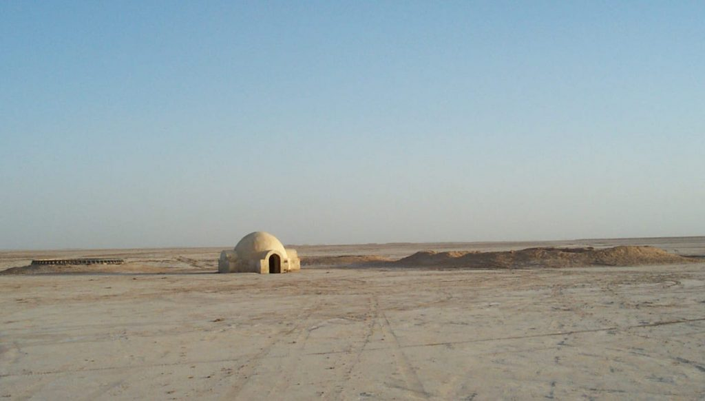 The igloo-shaped exterior of the Lars homestead was shot outside of Nefta, Tunisia, more than a 100 miles from Hotel Sidi Driss, which represented the interior of their crater. (Via Prop Store blog)