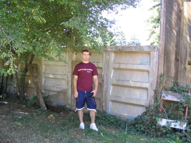 Brandon Alinger stood outside a fence built out of the Endor bunker panels near Smith River, California. To acquire those panels, Alinger and a friend had to replace the fence. (Courtesy of Brandon Alinger)