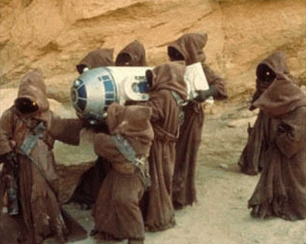 "Jawas snatch R2-D2 in a still from ""Star Wars."""