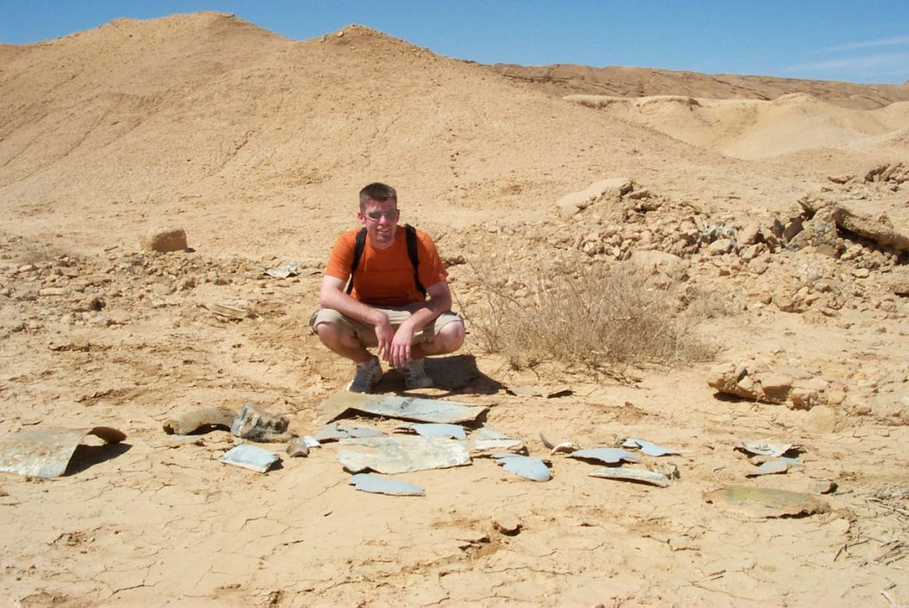 "In 2001, Alinger posed with the fiberglass fragments of the Nazi Flying Wing plane seen in ""Raiders of the Lost Ark."" This location near Tozeur, Tunisia, represented an archaeological dig in Tanis, Egypt, in the 1981 movie. (Via Prop Store blog)"