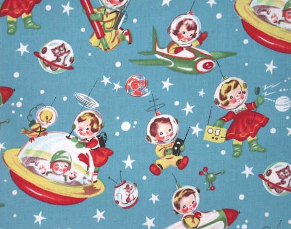 On this mid-century fabric, toddler boys and girls, as well as cats, mice, and birds, make the Space Race look just adorable. (Via eBay)