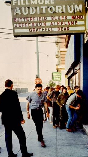 Bill Graham (walking toward camera at center) ran the Fillmore Auditorium from 1966 though the summer of 1968, when he moved operations across town to the Carousel Ballroom, which he renamed the Fillmore West. He was always a hands-on promoter.