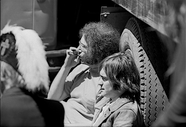 Jerry Garcia of the Grateful Dead smoking a joint with Marty Balin during a free summer concert at Speedway Meadow in Golden Gate Park, 1967. Courtesy of the Estate of Clay Geerdes.