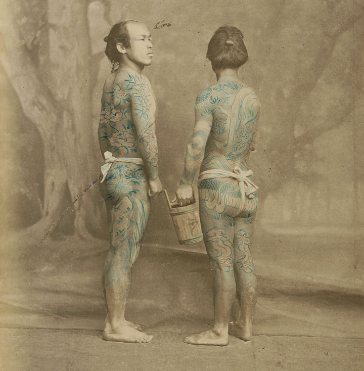 A hand-colored photograph of tattooed Japanese laborers by Felice Beato, circa 1870. Via Wikimedia.