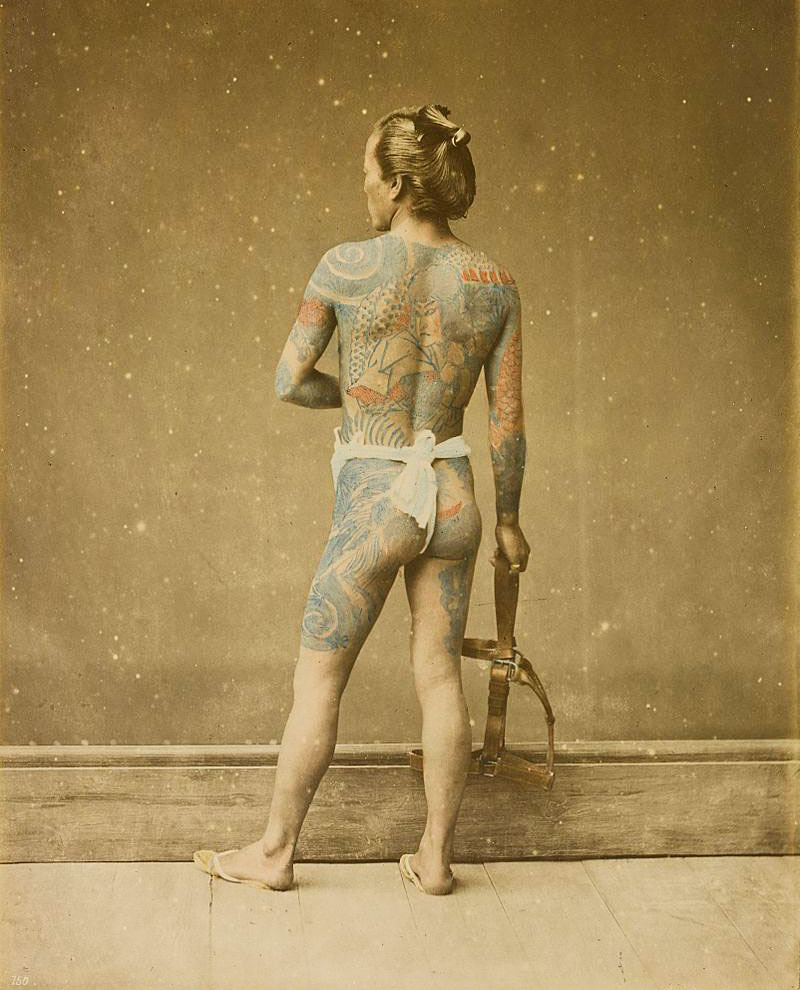 A hand-colored photograph of a tattooed Japanese laborer by Felice Beato, circa 1880s. Via Wikimedia.