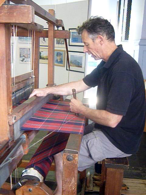 Tartan historian Peter MacDonald handweaving the MacDonald of Glenaladale tartan on a traditional single box flying shuttle loom. (Photo credit: EF Williams)