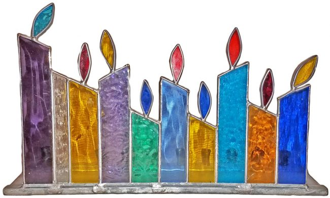 Chanukah candles burning behind this stained-glass menorah must be quite a sight on the holiday's final night.