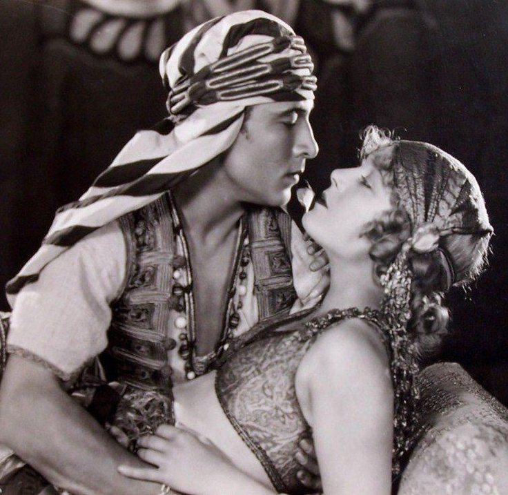 "Rudolph Valentino as Sheik Ahmed Ben Hassan seduces Agnes Ayres as Lady Diana Mayo in the 1921 silent film ""The Sheik."""