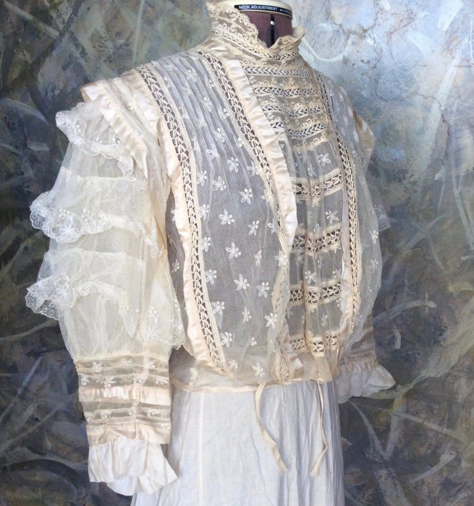 "An antique 1900s ""peekaboo"" cotton lace waistshirt, meant to be worn over multiple layers. (Via eBay)"