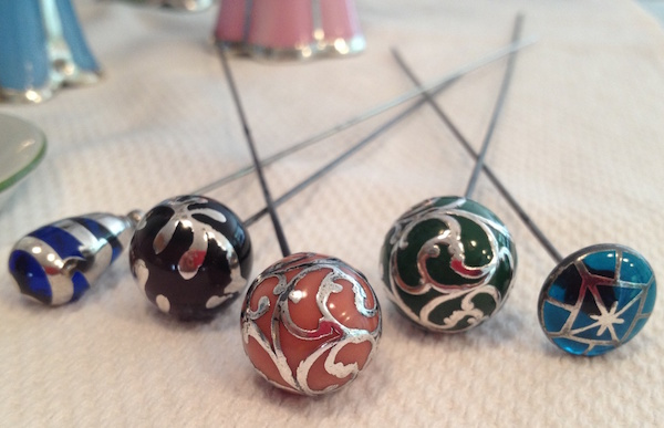 "Art Nouveau-era hat pins: ""Lovely examples of sterling overlay (coral and dark green spheres) and sterling deposit hatpins."" (Posted by Hatspins4me to Show & Tell)"