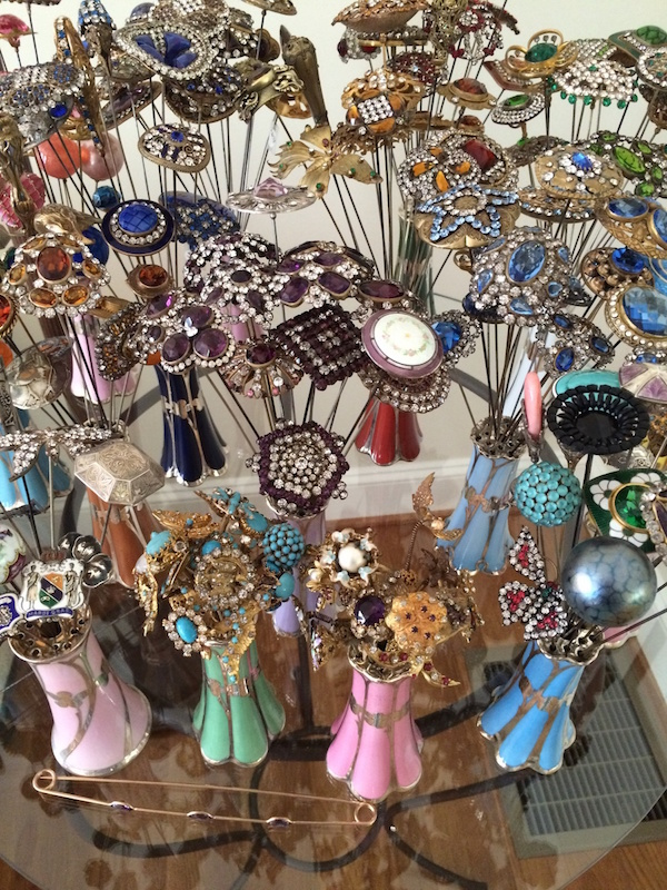 """Collector Hatpinholly shares her """"favorite antique Victorian and Edwardian-era hatpins displayed in my collection of sterling silver overlay hatpin holders."""" (Posted to Show & Tell)"""