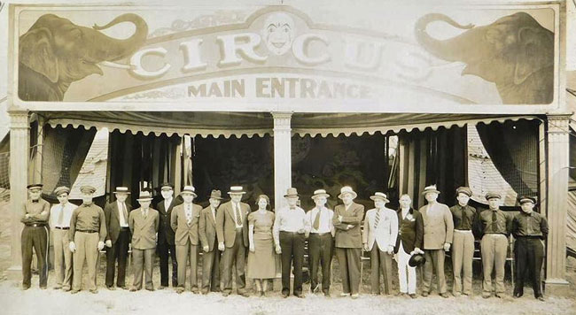 A photograph of a circus' staff and executives taken by Edward Kelty, circa 1940s.