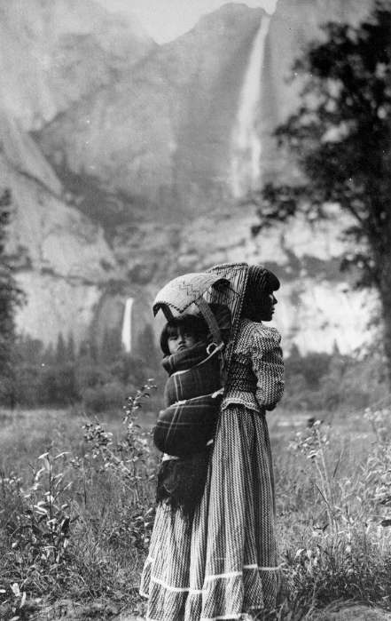 "Suzie McGowan carrying her daughter, Sadie, in Yosemite Valley, as photographed by J.T. Boysen, 1901. Via the <a href=""http://www.oac.cdlib.org/ark:/13030/kt6x0nc8tm/?brand=oac4"" target=""_blank"">San Joaquin Valley Library System</a>."