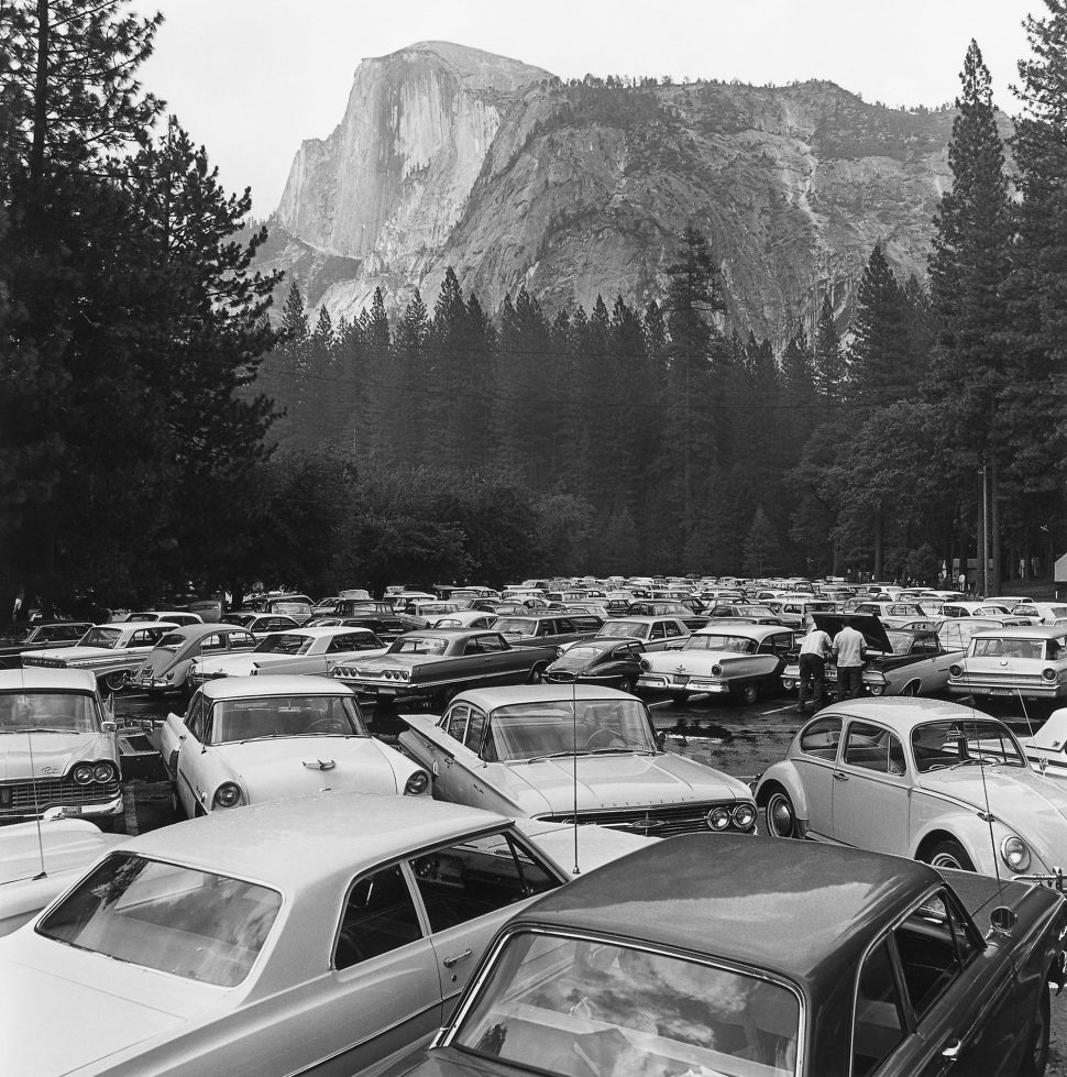 "The National Park Service's ""Mission 66"" initiative led to a mini-development boom to accommodate hordes of tourist traffic, as seen in this Rondal Partridge photograph of Yosemite, entitled ""Pave It and Paint It Green,"" circa mid-60s. Via the <a href=""https://www.loc.gov/item/2011645056/"" target=""_blank"">Library of Congress.</a>"