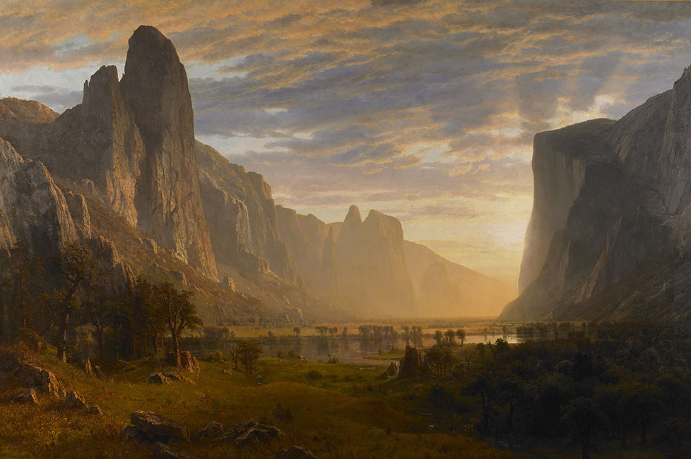 "In contrast to the indigenous camp depicted above, Bierstadt's 1865 painting ""Looking Down Yosemite Valley"" is a light-filled fantasy of unspoiled nature. Via Wikimedia. (Click to enlarge.)"