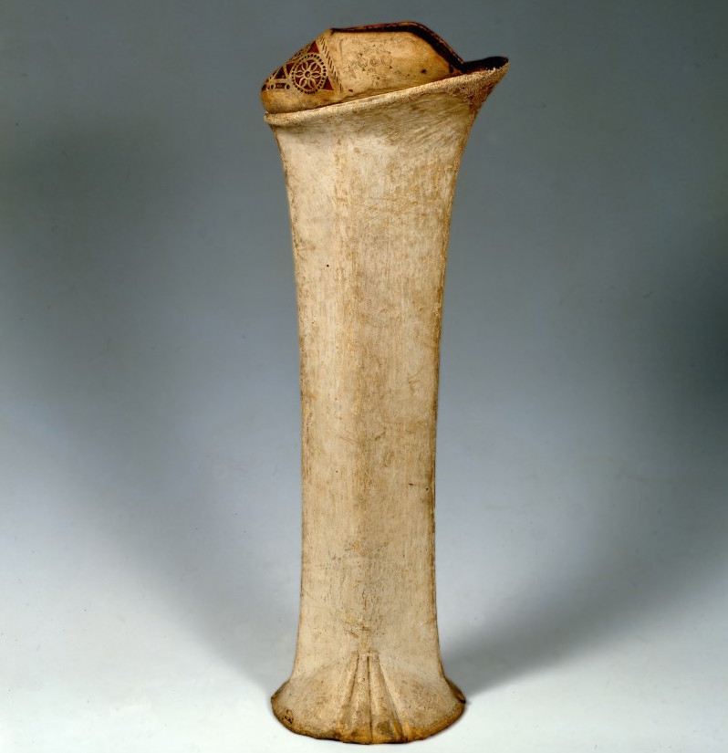 An extremely tall Venetian chopine made from wood covered in white leather with minimal ornamentation. (Courtesy the Bata Shoe Museum)